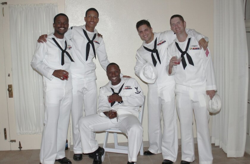 Crewmembers of the USS La Jolla enjoy a party in their honor.