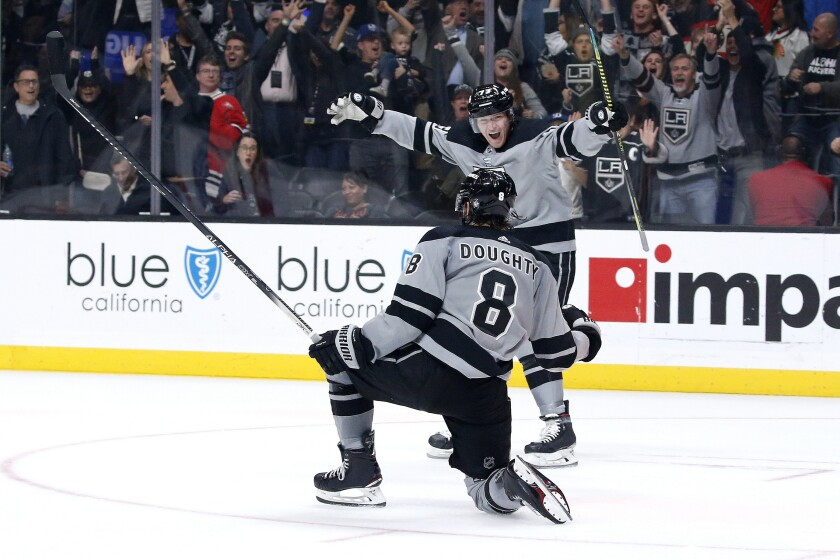 Kings defenseman Drew Doughty (8) celebrates his overtime goal with forward Tyler Toffoli in the team's game against the Chicago Blackhawks on Saturday at Staples Center. The Kings won 4-3.