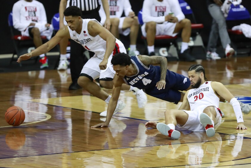Matt Mitchell, left, and Jordan Schakel, right, create a turnover Friday against Nevada in a Mountain West semifinal.