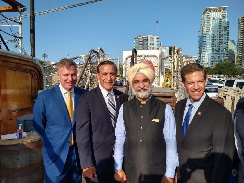 Ambassador Taranjit Singh Sandhu with Reps. Scott Peters, Darrell Issa and Mike Levin aboard the Star of India on Thursday.