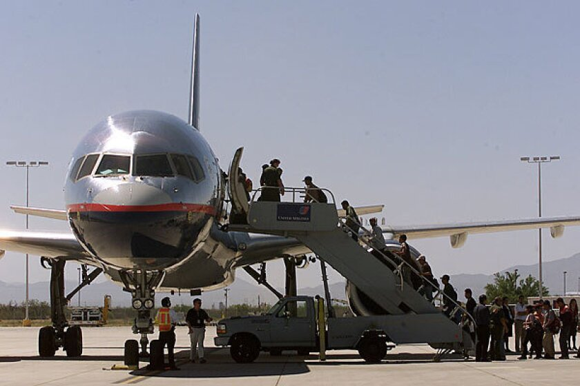 A file photo shows immigrants deported from the U.S. boarding a flight to Mexico City.