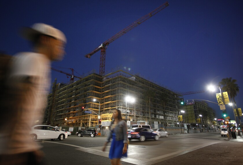 Pedestrians walk by the Blvd6200 project in Hollywood.
