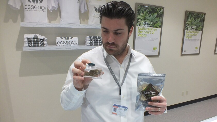 Armen Yemenidjian, founder of Essence Cannabis Dispensary, holds dried marijuana flowers and pot-laced cookies. They're among the many products medical marijuana cardholders, including those from California, can buy at the company's new store on the Las Vegas Strip.