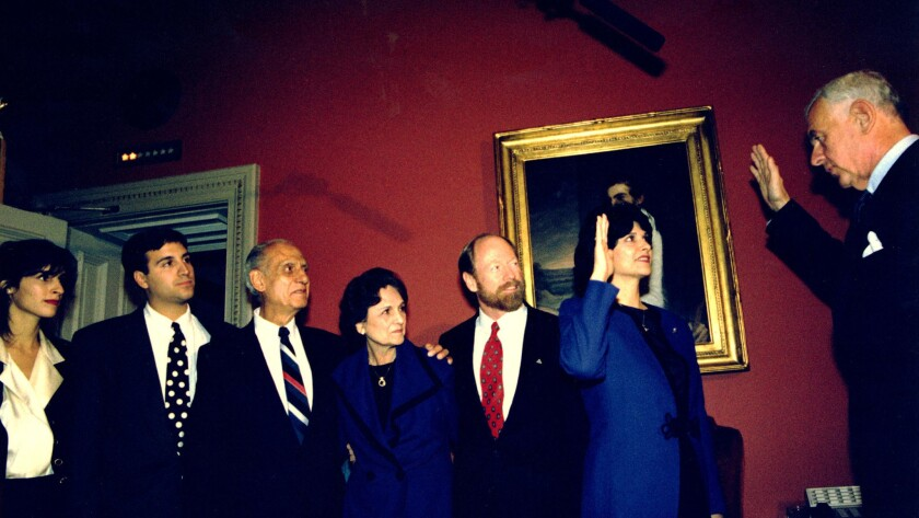 In 1993, members of the Roybal family, including former Rep. Edward Roybal, watch as his daughter, Rep. Lucille Roybal-Allard, takes the oath of office.