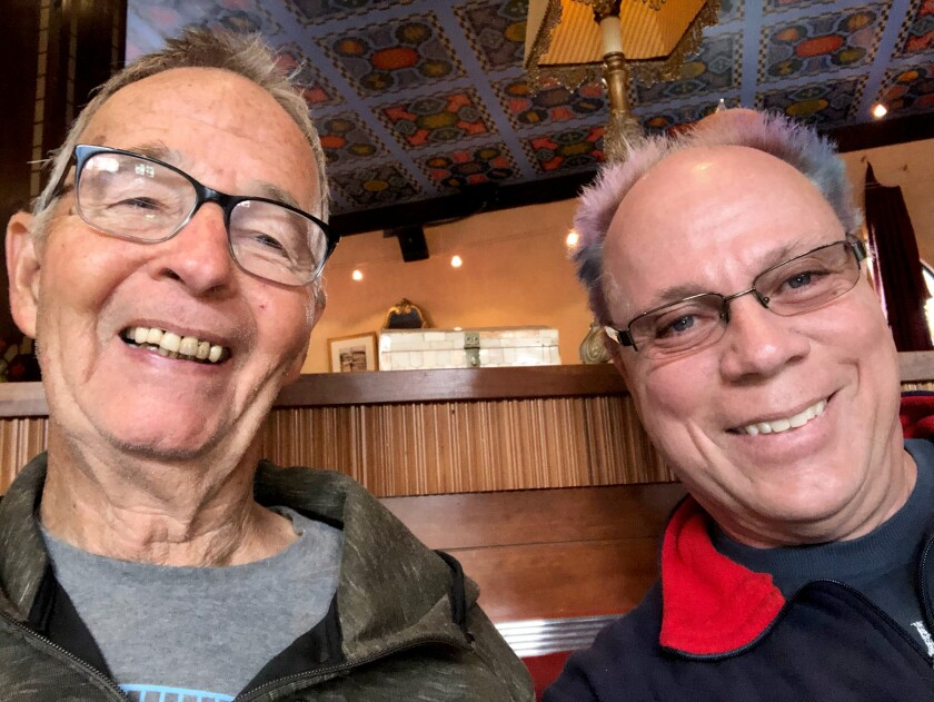 San Diego Civil rights attorney and LGBTQ activist Robert Lynn, (left) with his husband, Kleon Howe.