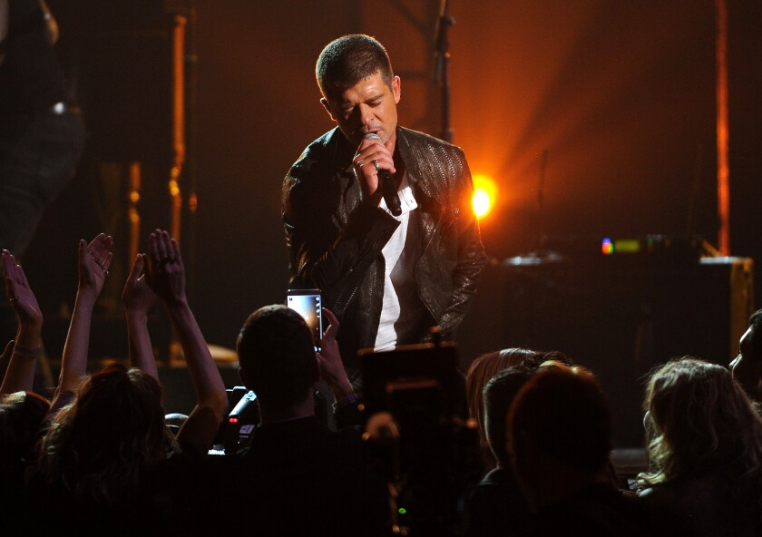 """""""I was high on Vicodin and alcohol when I showed up at the studio"""" to record """"Blurred Lines"""" and had little to with writing the song, Robin Thicke testified in a deposition. Above, the singer onstage in Las Vegas in May."""