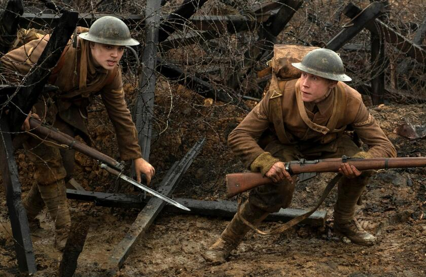 """Dean-Charles Chapman, left, and George MacKay in a scene from Universal Pictures and Amblin Entertainment's """"1917."""""""