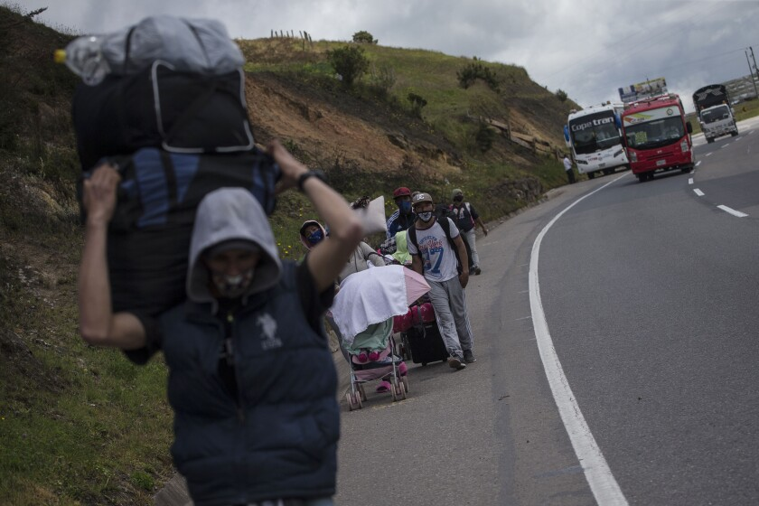Venezuelan migrants walk to Bogota, Colombia.