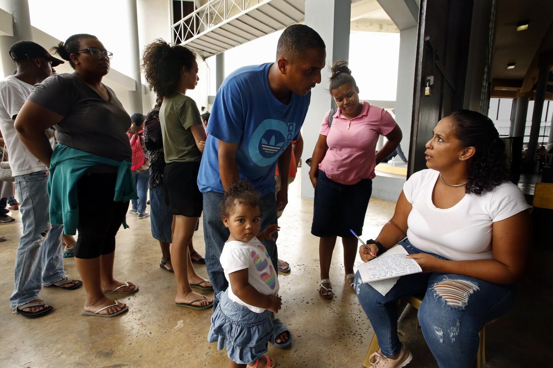Jason Castro his daughter Hennessey Castro, age 2, receive FEMA food aid in Rio Grande, Puerto Rico.