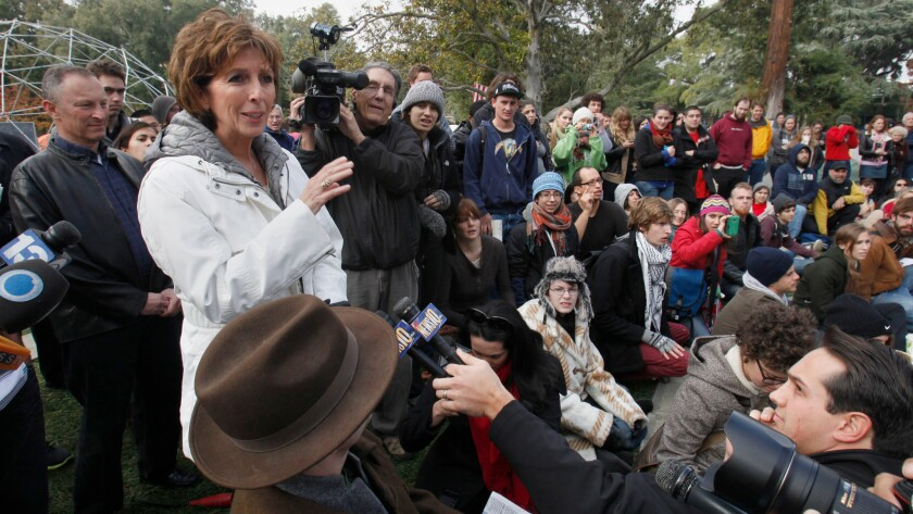 Linda Katehi, then the Chancellor of UC Davis, attempts to address students gathered at an Occupy UC Davis encampment in 2011.