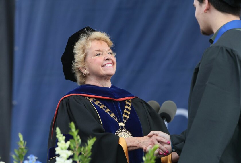 Cal State San Marcos President Karen Haynes greets a graduate at the school's College of Business Administration Commencement.