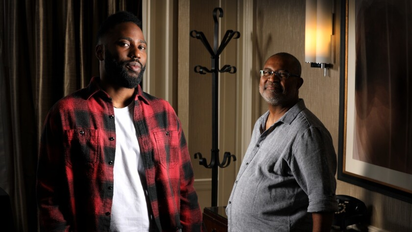 """John David Washington, left, plays the role of Ron Stallworth, right, in Spike Lee's """"BlacKkKlansman."""" Stallworth was a cop who managed to infiltrate the KKK in 1979."""