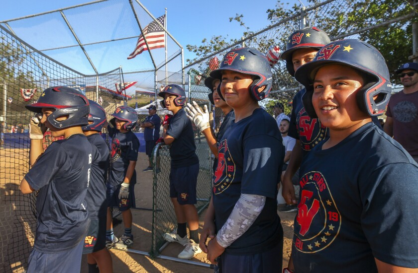 The Sweetwater Valley Little League All-Stars players watch the ball hit by a teammate sail into the outfield during batting practice at the Sweetwater Valley Sports Complex on Thursday.
