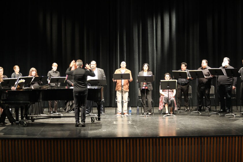"""A vocal and piano workshop performance, hosted by San Diego Opera on Dec.13, of the Spanish-language opera """"El Ultimo Sueno de Frida y Diego"""" at Smith Recital Hall at San Diego State University. Conductor Bruce Stasyna, center, leads the workshop which starred a chorus and principal singers, left to right from Stasyna's right: Nelson Martinez as Diego Rivera, Darryl Taylor as Leonardo, Guadalupe Paz as Frida Kahlo and Tasha Koontz as Catrina."""
