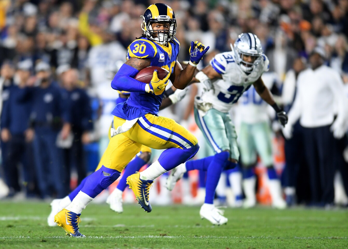 Rams running back Todd Gurley beats Dallas Cowboys cornerback Byron Jones for a 35-yard touchdown during the second quarter.