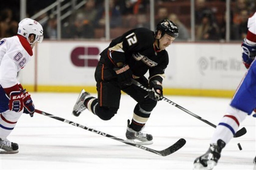 Anaheim Ducks left wing Niklas Hagman (12) controls the puck ahead of Montreal Canadiens defenseman Yannick Weber (68) in the second period of an NHL hockey game in Anaheim, Calif., on Wednesday, Nov. 30, 2011. (AP Photo/Christine Cotter)