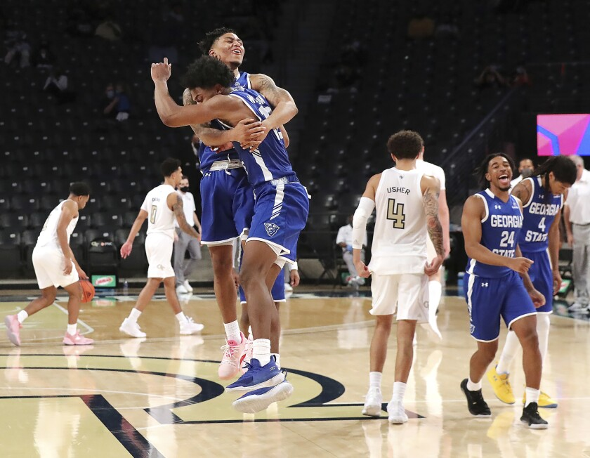 Georgia State players celebrate after defeating Georgia Tech 123-120 in four overtimes in an NCAA college basketball game, early Thursday, Nov 26, 2020, in Atlanta. (Curtis Compton/Atlanta Journal-Constitution via AP)