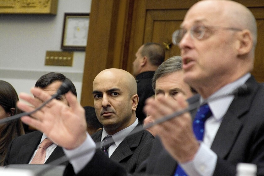 Neel Kashkari, center, then interim assistant Treasury secretary for financial stability, listens as then-Treasury Secretary Henry M. Paulson testifies in 2008 at a House Financial Services Committee hearing on TARP.