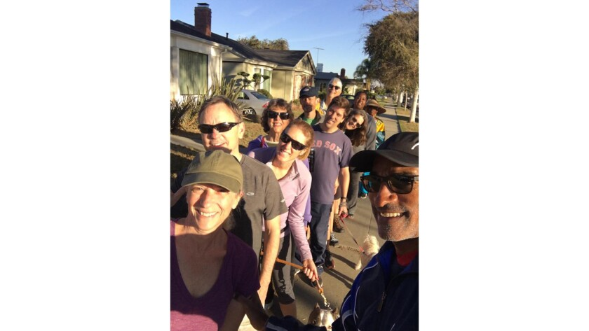 The many white faces in a selfie of his Saturday running club posted on Facebook by DeMille Halliburton, right, in October set off a storm of debate in Leimert Park, a middle-class, traditionally Af