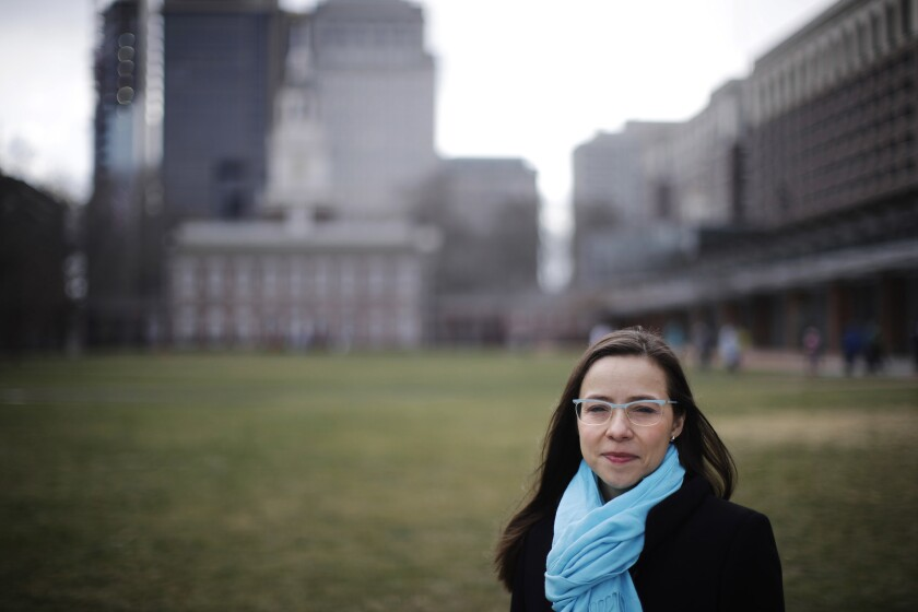 Rhea Powell poses for a photograph in view of Independence Hall in Philadelphia on Feb. 2, 2017. The massive turnout for last month's women's marches protesting the policies of the Trump administration have led to calls for sustained political activism to help Democrats get back in power.
