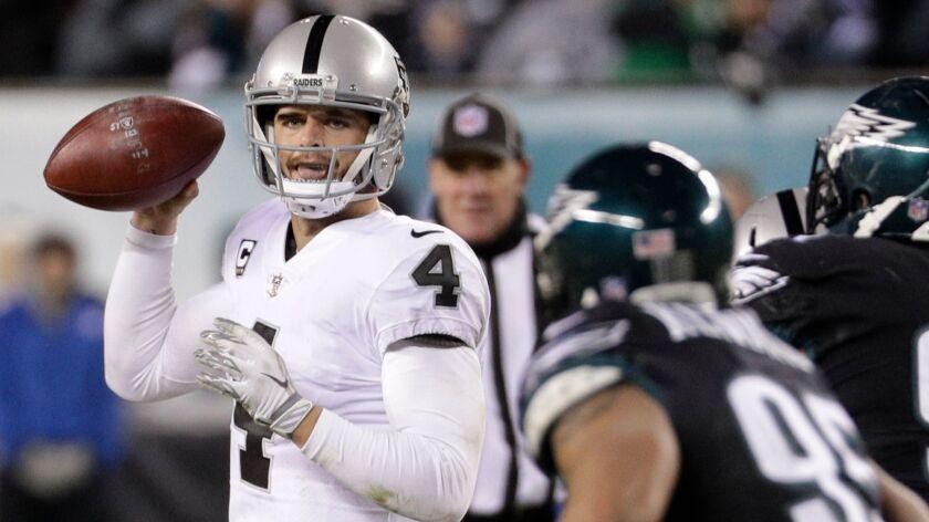 Oakland Raiders' Derek Carr prepares to throw in a game against the Philadelphia Eagles,