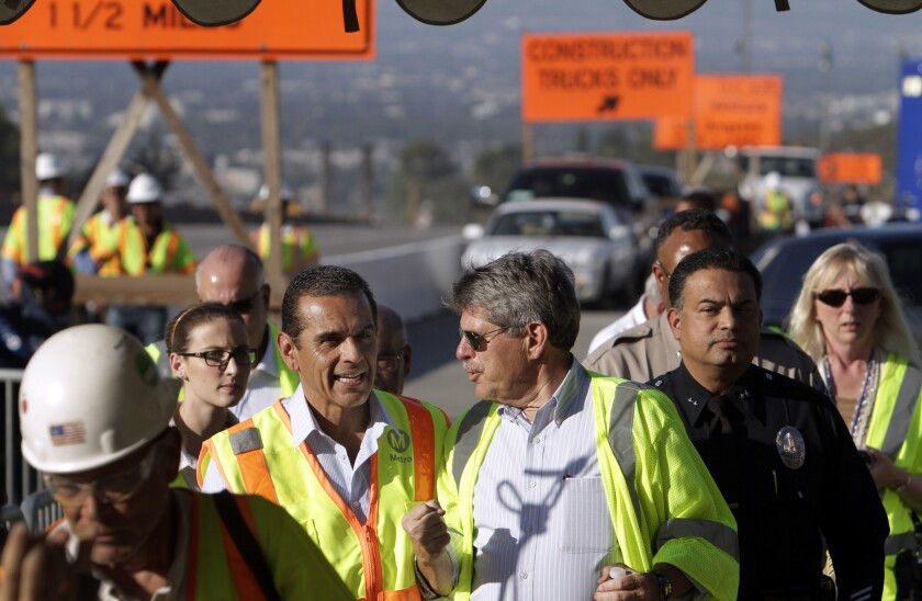 Los Angeles County supervisor Zev Yaroslavsky, with then-Los Angeles Mayor Antonio Villaraigosa, at the site of the Mulholland Bridge demolition in 2012. The Metro board voted Thursday to change the name of the Red Line terminus to North Hollywood/Zev Yaroslavsky station in his honor.