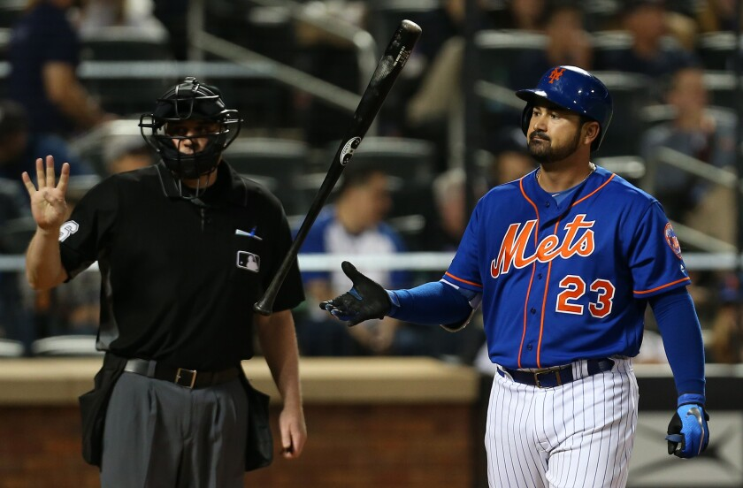 Adrian Gonzalez #23 of the New York Mets flips his bat after striking out against the New York Yankees during the fourth inning of a game at Citi Field on June 10, 2018 in the Flushing neighborhood of the Queens borough of New York City.