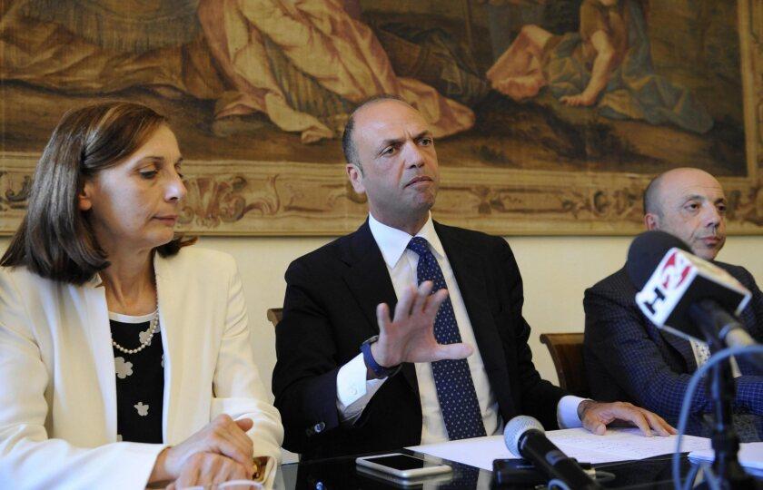 Prefect Mara Di Lullo, left, Italian Interior Minister Angelino Alfano and Fermo Procutor Domenico Seccia at a news conference about Emmanuel Chidi Namdi.