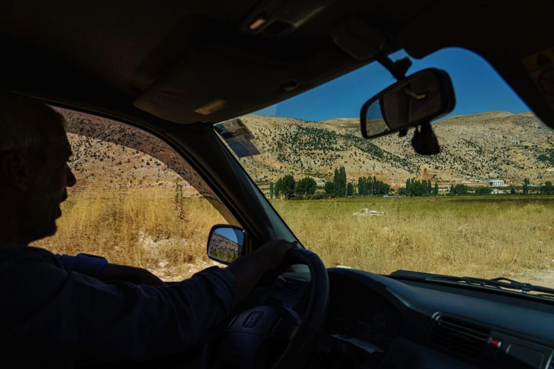 Farmer Ali Shreyf driving through Yammouneh, Lebanon.