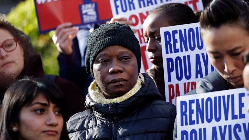 People rally in New York to protest the decision by the Trump administration to end so-called temporary protected status for immigrants from Haiti.