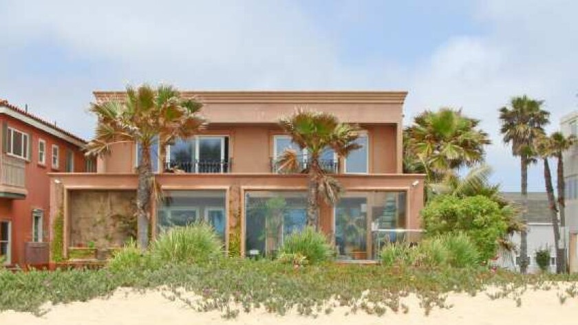 The beachfront Mediterranean that Jesse James recently sold sits on the sand in Sunset Beach.