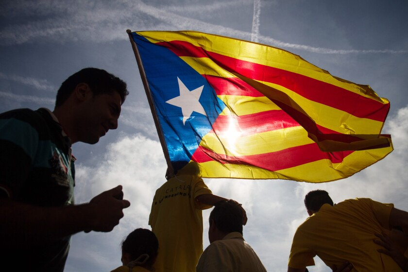 A young child is seen holding the Catalan flag alongside a group of Catalonia's pro-independence demonstrators during a rally in Barcelona, Spain, last month.