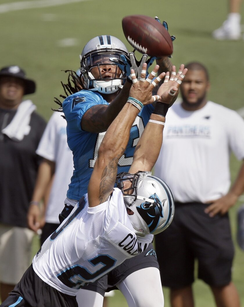 Carolina Panthers' wide receiver Kelvin Benjamin, top, brings in a pass as Kurt Coleman defends during the NFL football team's training camp in Spartanburg, S.C., Friday, July 29, 2016. (AP Photo/Gerry Broome)