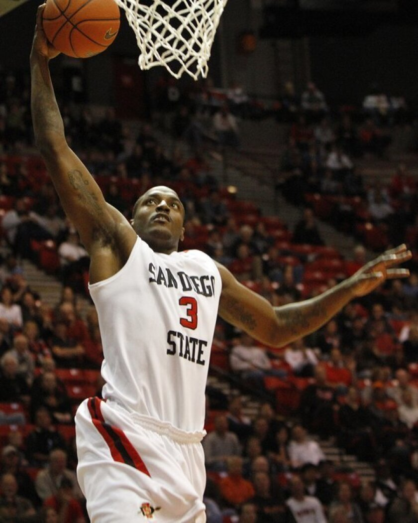Tyrone Shelley goes up for a slam in a game in mid-January 2010.