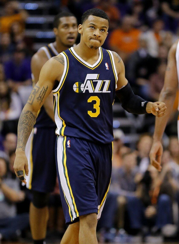 Utah Jazz guard Trey Burke (3) celebrates his basket against the Phoenix Suns during the second half of an NBA basketball game on Saturday, Nov. 30, 2013, in Phoenix. The Jazz won 112-104. (AP Photo/Matt York)