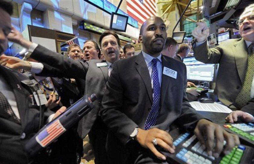 Specialist Damen Watson, second from right, is surrounded by traders at the post that handles MasterCard on the floor of the New York Stock Exchange at the close of trading Wednesday, Jan. 14, 2009. (AP Photo/Richard Drew)