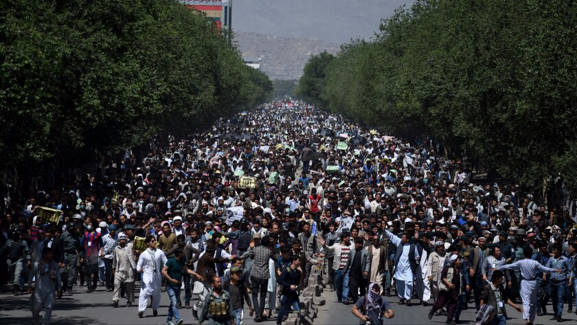 Afghans led by members of the Hazara ethnic minority took to the streets of Kabul on May 16, 2016, to protest the controversial rerouting of a new power line away from Bamiyan province, which has a large Hazara population.