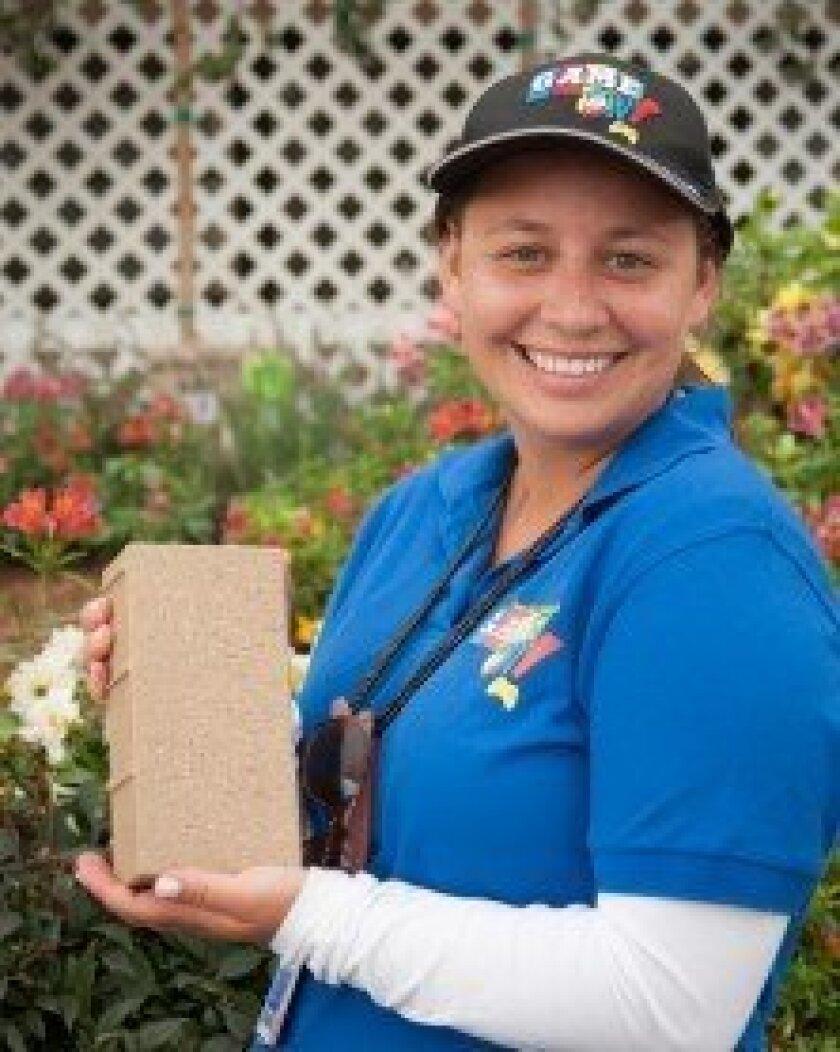 Julie Woods displays a Don Diego Legacy Brick.