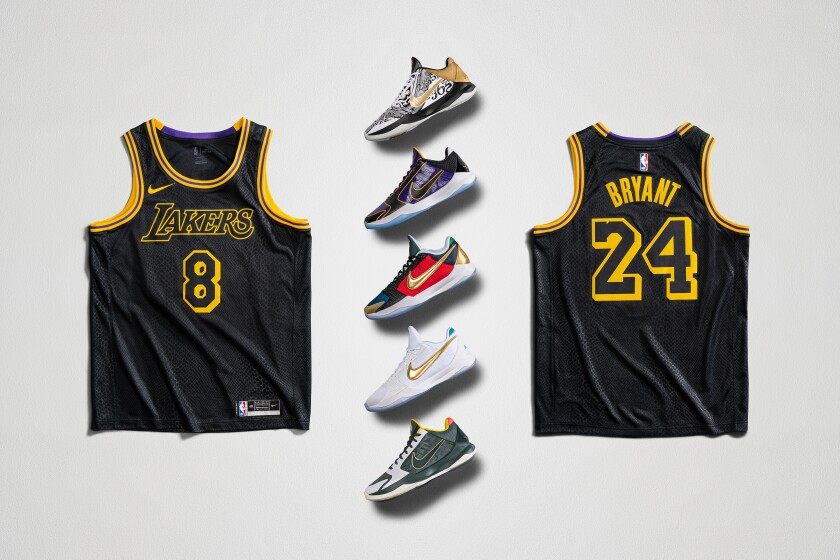 Five sneakers and the front and back of a basketball jersey.