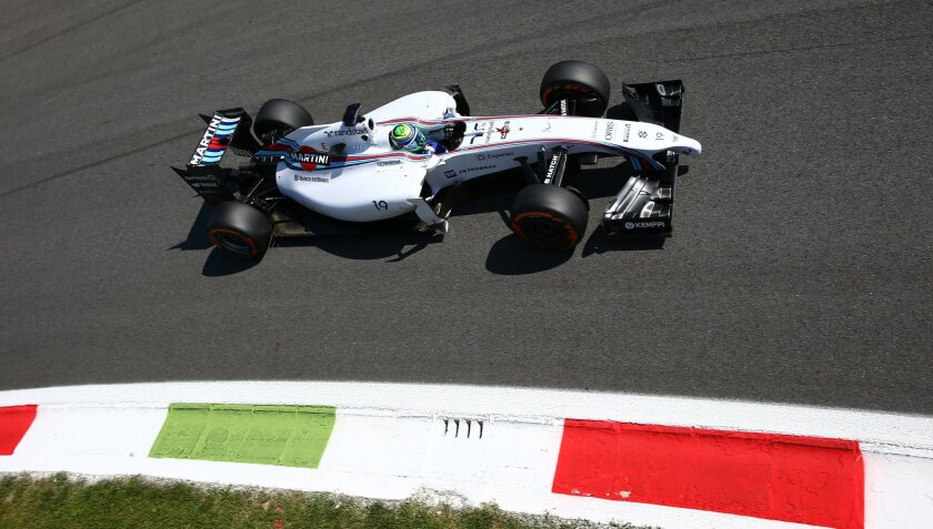 Brasil's Felipe Massa steers his Williams on his way to clock the fourth fastest time during the qualifying session at the Monza racetrack, in Monza, Italy, Saturday, Sept. 6 , 2014. The Formula one race will be held on Sunday. (AP Photo/Alessandro Trovati)