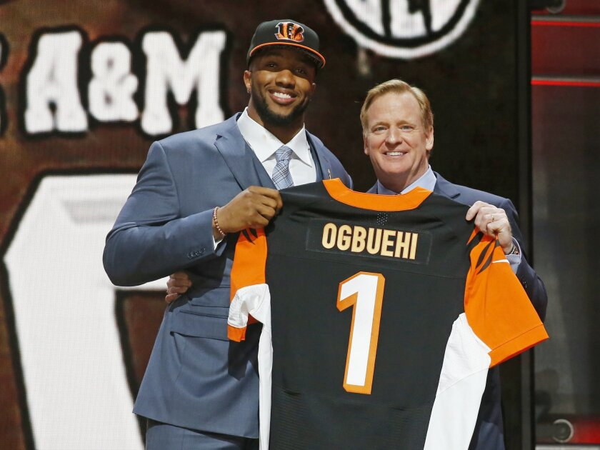 Texas A&M offensive lineman Cedric Ogbuehi poses for photos with NFL commissioner Roger Goodell after being selected by the Cincinnati Bengals as the 21st pick in the first round of the 2015 NFL Draft,  Thursday, April 30, 2015, in Chicago. (AP Photo/Charles Rex Arbogast)
