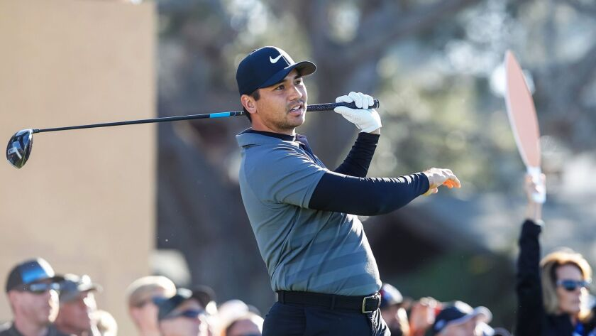 Jason Day tees off on the 10th hole north course on Friday during the Farmers Insurance Open round 2 in San Diego, California.