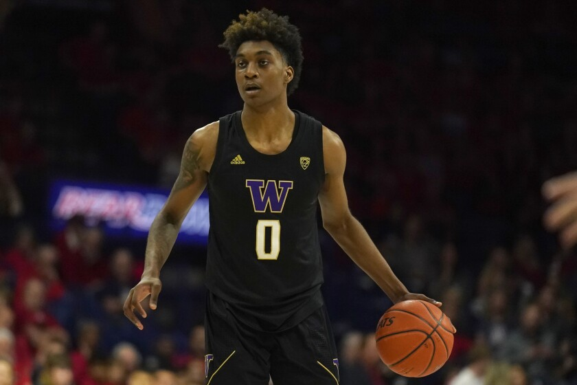 Washington forward Jaden McDaniels brings the ball up court during a game against Arizona on March 7, 2020, in Tucson.