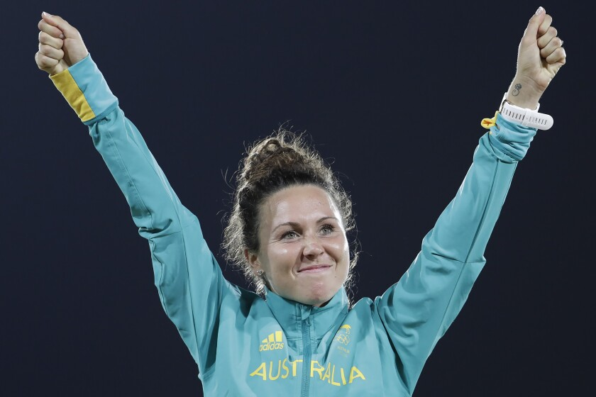 """FILE - In this Aug. 19, 2016, file photo, Chloe Esposito of Australia celebrates winning the gold medal at the awards ceremony of the women's modern pentathlon at the Summer Olympics in Rio de Janeiro, Brazil. Esposito announced in late January that a """"wonderful, unexpected surprise"""" had occurred and that the Australian wouldn't be able to defend her modern pentathlon gold medal at the Tokyo Olympics. She was pregnant with her first child. Two months later Esposito and thousands of other Olympic athletes learned that the Tokyo Games would be put off by a year until July 2021 because of the coronavirus pandemic. While for some it meant more time to recover from injuries or extra time to prepare, Esposito realized it might give her a second chance to be in Tokyo next year. (AP Photo/Natacha Pisarenko, File)"""