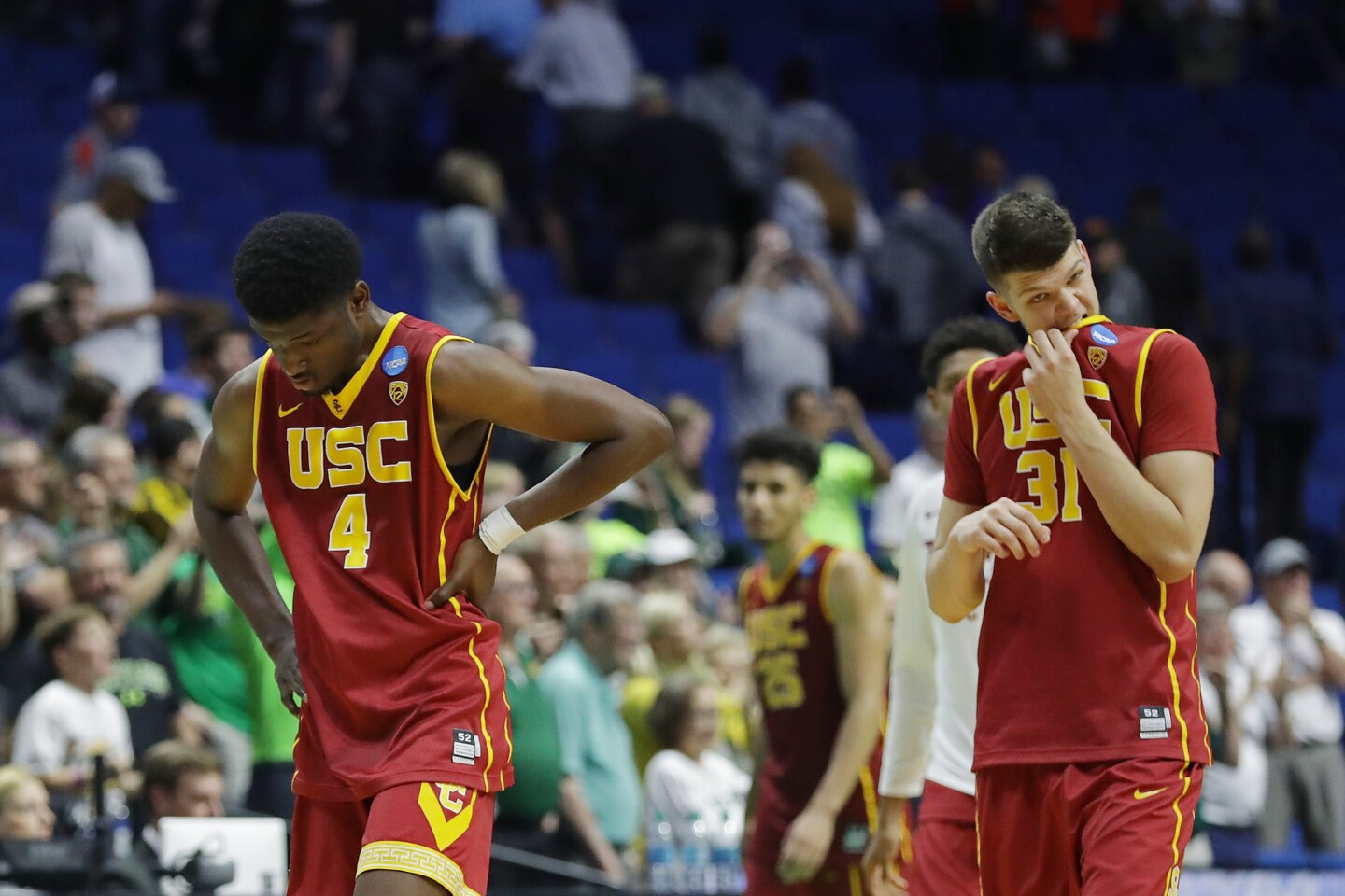 USC big men Chimezie Metu (4) and Nick Rakocevic (31) leave the court after their 82-78 loss to Baylor in an NCAA tournament second-round game Sunday.