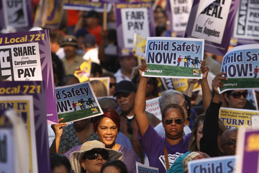 Thousands of Service Employees International Union members rally during a march at the California Plaza in downtown Los Angeles. The march ended at the Kenneth Hahn Hall of Administration.