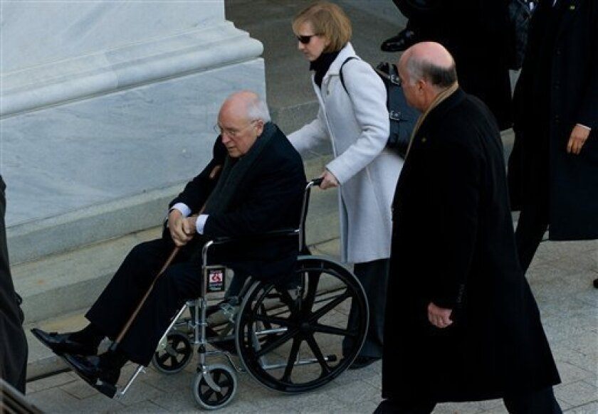 Vice President Dick Cheney arrives in a wheelchair at the U.S. Capitol for the inauguration of Barack Obama as the 44th president in Washington, Tuesday, Jan 20, 2009. (AP Photo/Saul Loeb, Pool)