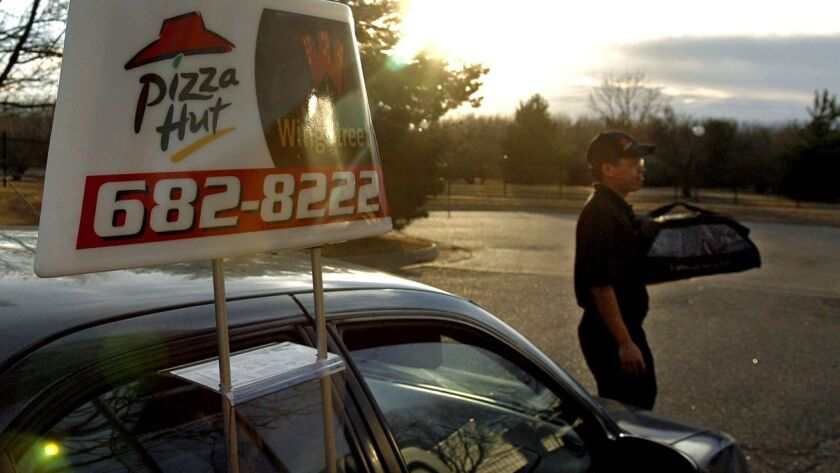 First, Pizza Hut began delivering beer. Now, a self-driving car may bring your pizza