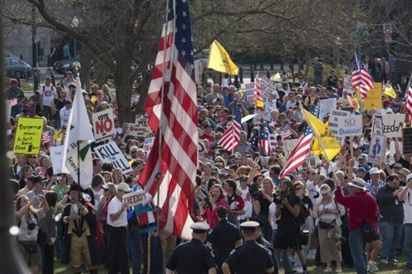 FILE - In this March 20, 2010 file photo, tea party demonstrators protest outside of the House Chamber on Capitol Hill in Washington. (AP Photo/Harry Hamburg, File)