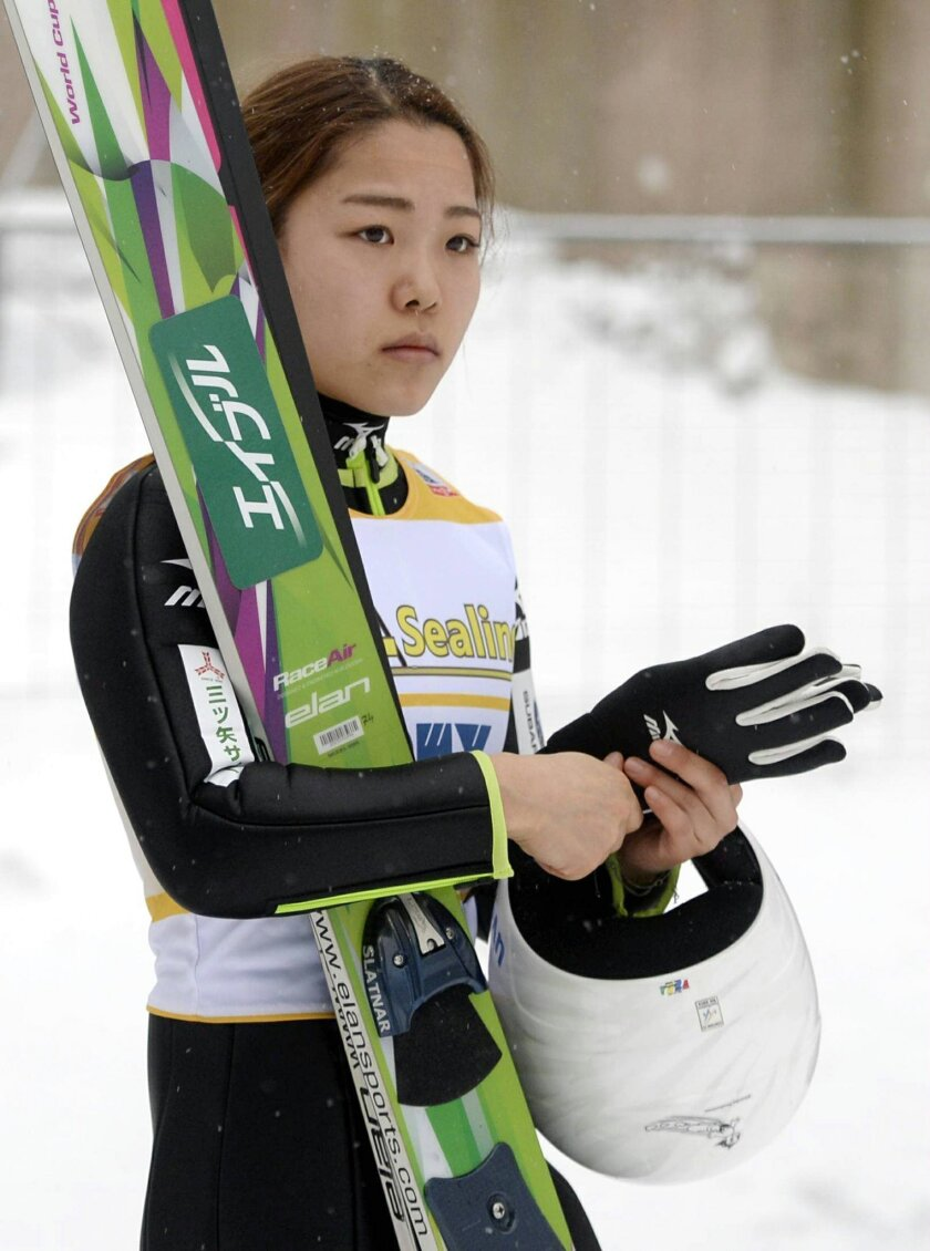 Sara Takanashi of Japan pauses after her jump in the ladies' ski jumping HS100 World Cup competition at the Lahti Ski Games, the Pre-World Championships, in Lahti, Finland, Friday, Feb. 19, 2016. Takanashi secured the overall ski jump World Cup title for 2015-16 by winning thes event. (Jussi Nukari
